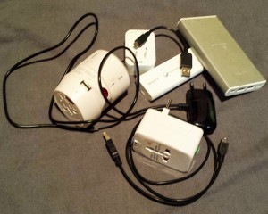 Some of the plugs, adapters, cables and batteries that I needed to keep powered up and operational