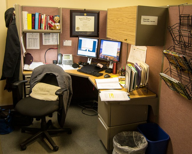 Photo: a work station in an office cubicle
