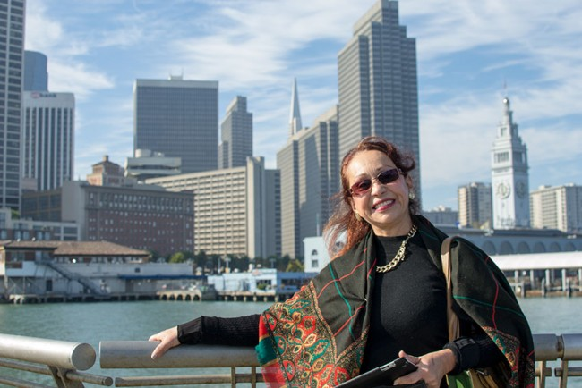 Photo: woman poses with San Francisco skyline behind